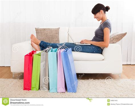 couch shopping online young woman shopping online stock photo image 34957410