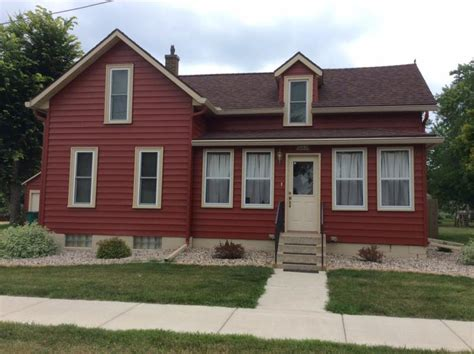houses with red siding red siding boelter window siding and seamless gutters