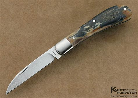 Tom Handcrafted Knives - tom ploppert damascus wharncliff trapper knifepurveyor