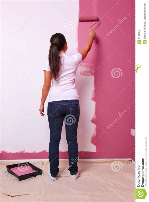 woman painting  wall rear view royalty  stock images