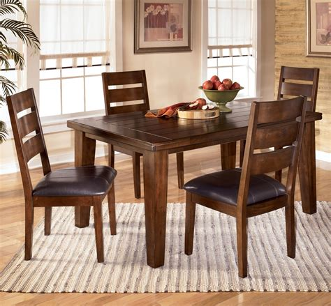 ashley dining room furniture set signature design by ashley larchmont 5 piece rectangular