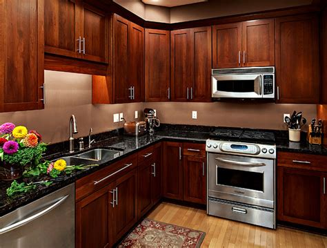 kitchen ideas with cherry cabinets cherry kitchen cabinets rockford door style cliqstudios contemporary kitchen
