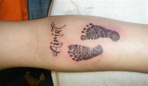 Baby Footprints With Name Tattoos On Arm Tattooshunt Com Child Name Tattoos On Arm