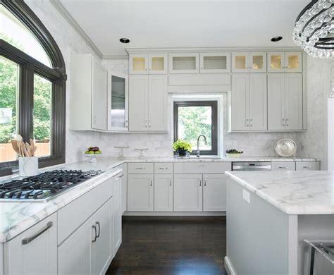 kitchen cabinets with windows behind stove under window transitional kitchen