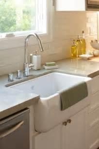 Kitchen with white porcelain farmhouse sink white flat panel kitchen