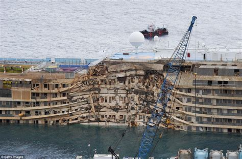 boat sinking by miller ferry costa concordia salvage wrecked cruise ship towed on its