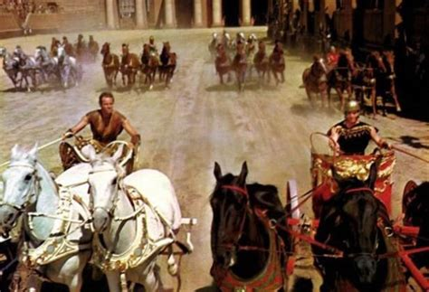 Tasya Benhurred 4 during the chariot in ben hur a small car can be seen in the distance and heston is