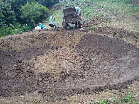 Digging A Backyard Pond by Building A Pond Landscape Garden Designers