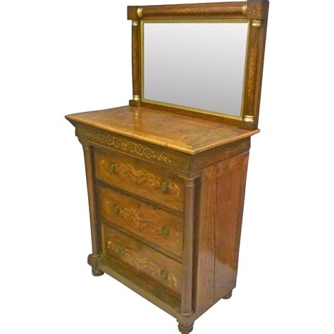 inlaid mahogany chest of drawers with mirror from