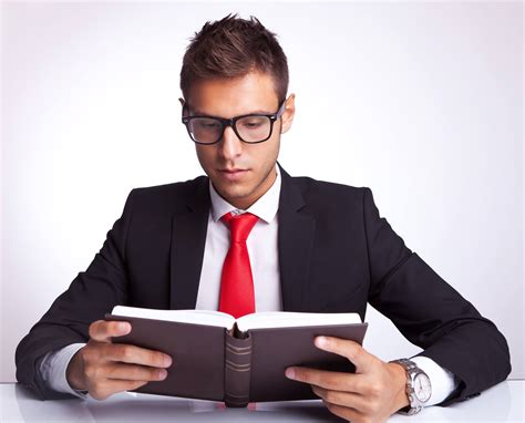 picture of someone reading a book 10 must read books for leaders