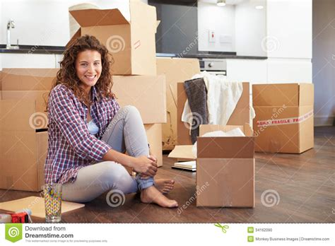Move Your On The Floor by Moving Into New Home And Unpacking Boxes Stock Photo