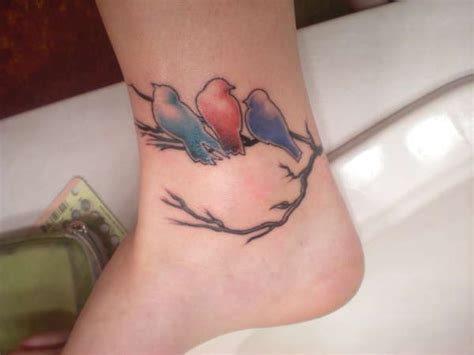 birds on a branch tattoo with three birds on branch