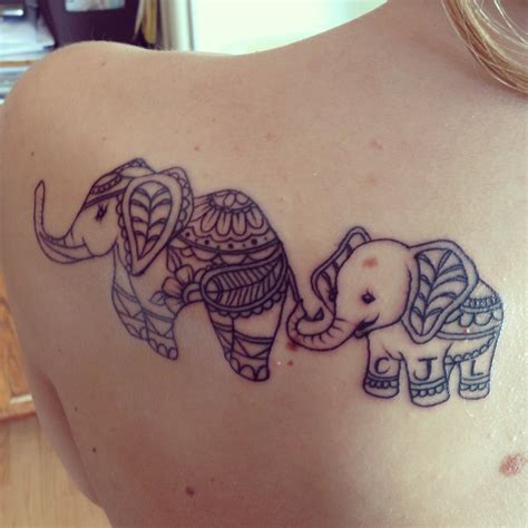 mother son tattoo elephant and initials tattoos