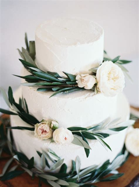 white wedding cake  greenery  pink floral