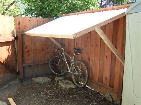 fence supported bike shelter built  client  bike