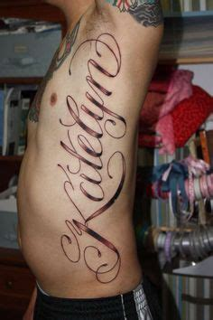 tattoo of couple hanging from tree rib cage name tattoo idea rib cage tattoo designs and