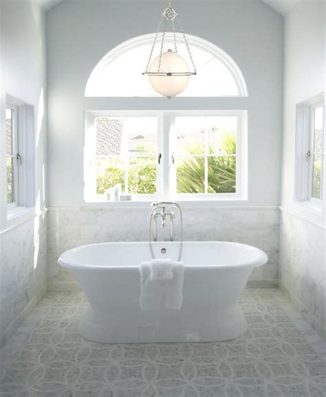 chandelier over bathtub mosaic marble floor traditional bathroom courtney