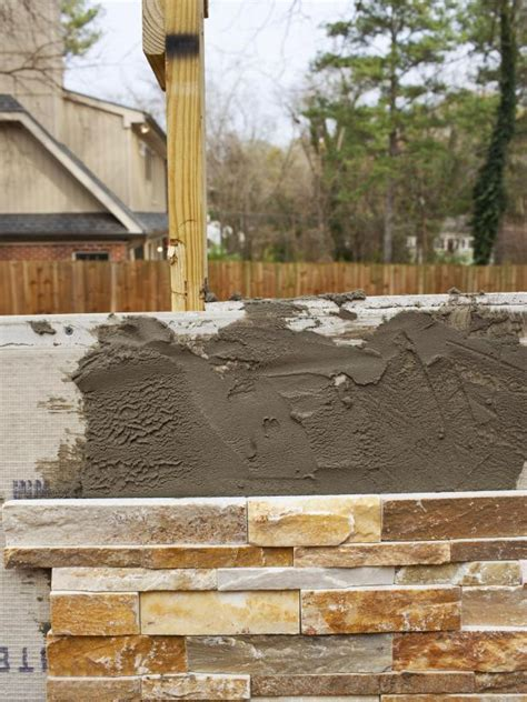 how to build an outdoor stacked fireplace hgtv