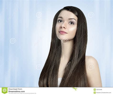 photos of lovely dark black long silky hairs of indian chinese girls in braided pony styles beautiful brunette woman with long shiny hair stock photo