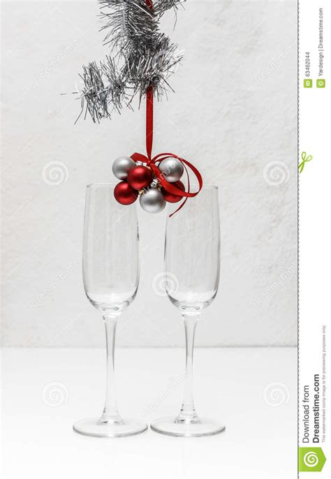 greeting card template    champagne glasses  red  silver balls hanging  red