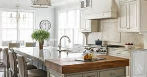 Kitchens Islands With Seating cream tumbled marble kitchen backsplash transitional