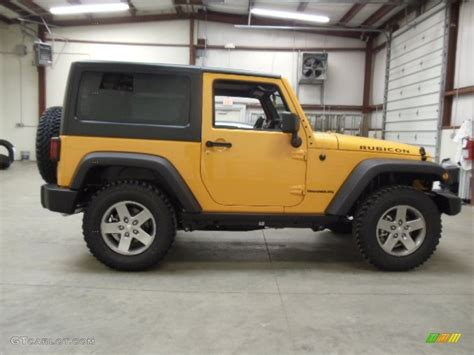 jeep rubicon yellow dozer yellow 2012 jeep wrangler rubicon 4x4 exterior photo