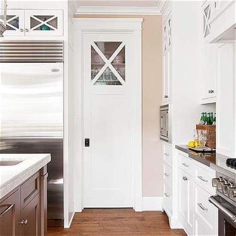 glossy cafe au lait upper cabinets in small space kitchen bhg kitchens cafe au lait tan walls pocket door
