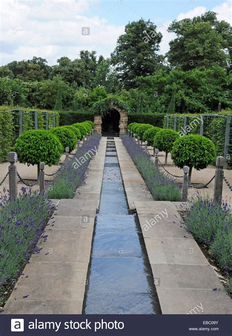 a water rill with lavender and box topiary hedges in the garden of stock photo royalty free