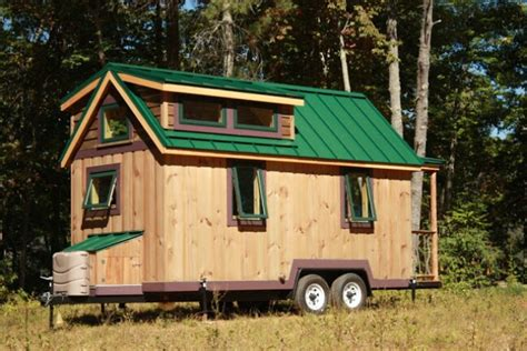 tiny house tour the second wall goes up the comet cer young couple s 330 sq ft tiny house was designed with