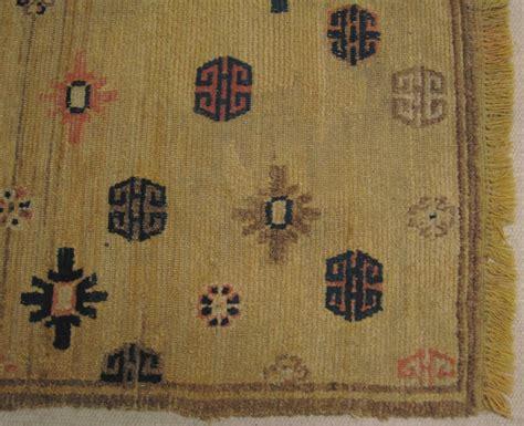 tibetan prayer rug mid 19th century tibetan prayer rug in ningxia yellow size 84cm x 141cm fringes on both ends