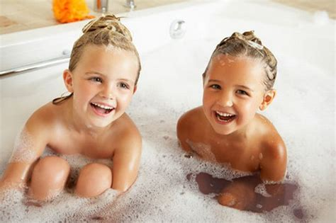 naked girls in a bathroom when should your children stop bathing together