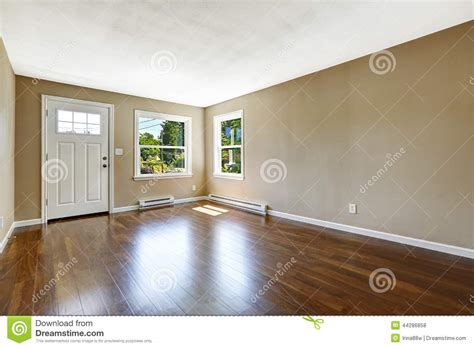 Home Floor Plans And Prices by Empty House Interior Hardwood Floor And Beige Walls