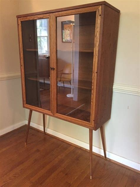 mid century glass front display cabinet  broyhill