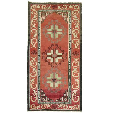 vintage turkish rug inspired by 19th century khotan