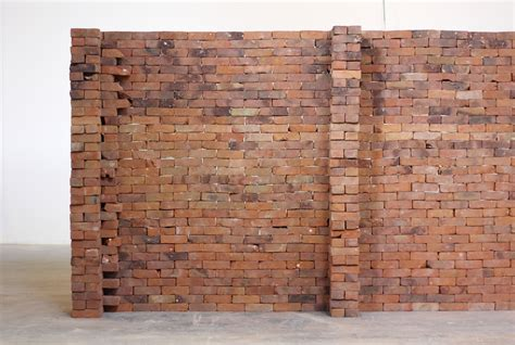 single book disrupts  foundation   brick wall  jorge mendez blake colossal