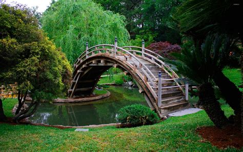 japanese bridges wooden bridge in a japanese garden wallpaper world