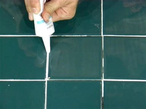 how to fix bathroom grout how to repair cracked tiles how tos diy
