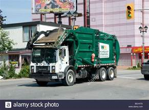 Garbage Truck by A Mack Garbage Truck Passes Through Town Niagara