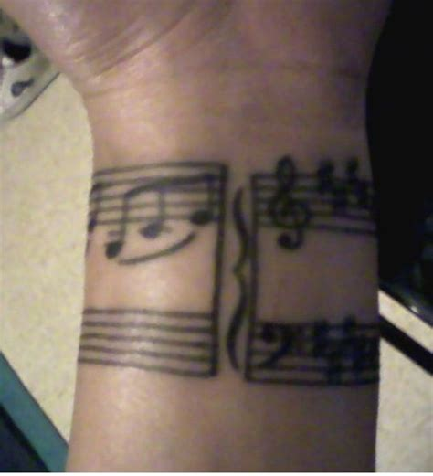 music bar tattoo designs staff wrap around wrist tattoos