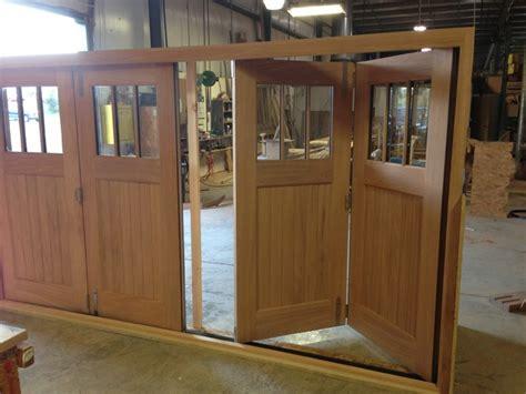 Folding Garage Door by Slide Fold Doors Custom Wood Garage Doors Carriage House