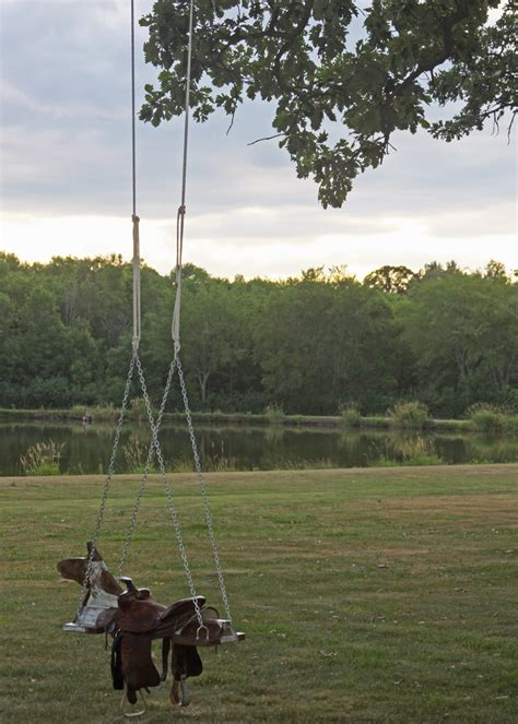 swing horse outdoor horse and saddle swing a spotted pony