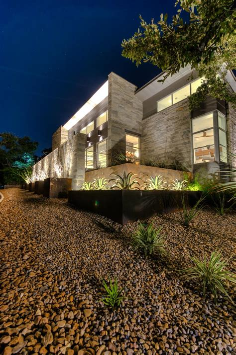 modern home with grass free landscaping jms architects