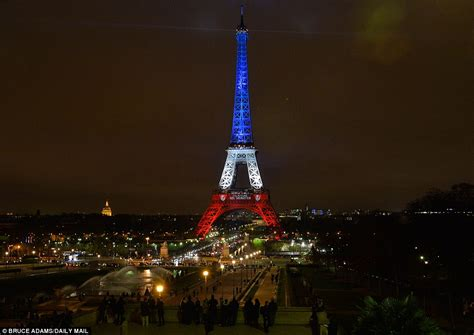 Lit Up by The Eiffel Tower Is Lit Up With The Tricolore As It