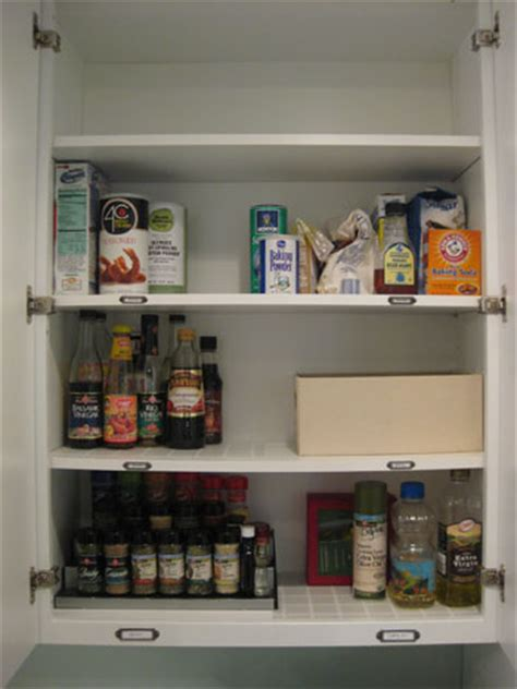 young house love kitchen cabinets organizing our kitchen cabinets spices pantry items