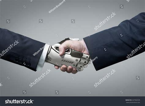 intelligent design concept unscientific business human robot hands handshake artificial stock