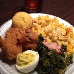 southern sunday dinner fried chicken mac cheese greens deviled egg and corn muffin yum