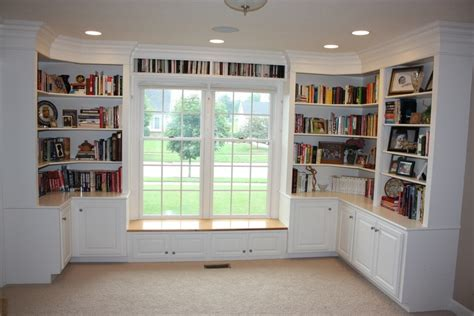 wrap around bookcases with cabinets and a window seat the