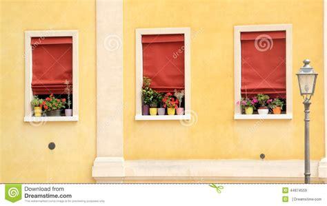 yellow walls red curtains three windows stock photo image 44874559