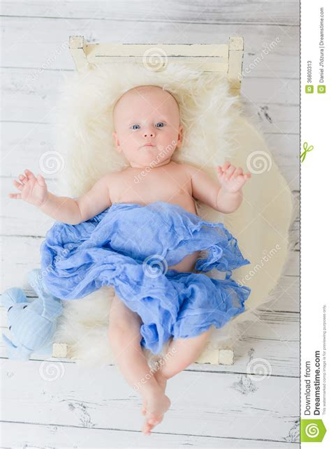 small baby bed infant lies in a small baby bed wrapped blue soft material stock photos image 36800313