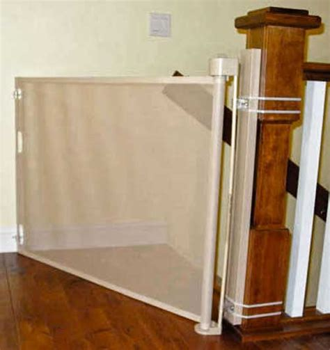 top of stairs banister baby gate retract a gate retractable safety gate an easy to use wide retractable safety gate